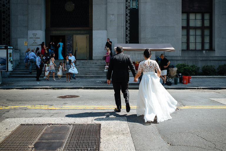 Wedding couple walking into City Hall to get married