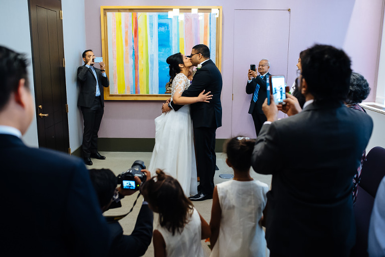Couple kisses at the end of their City Hall ceremony