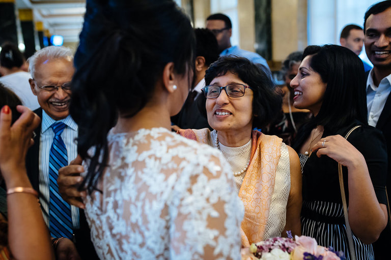Mother congratulates bride