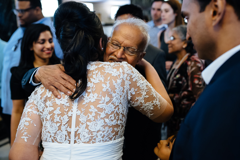 Father of the groom hugs bride