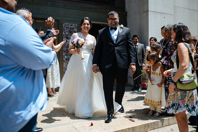 Bride and groom exiting City Hall