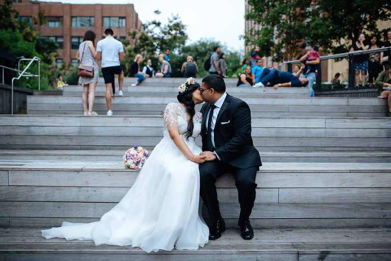 Bride and groom kissing on The High Line
