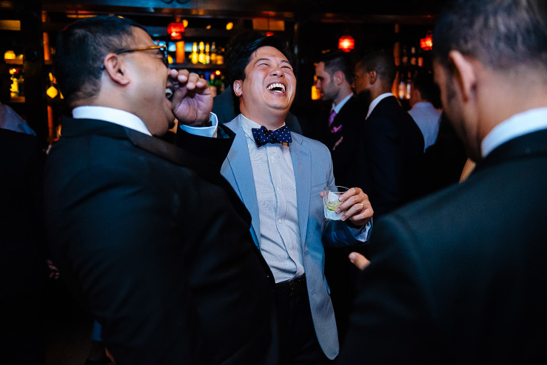 Groom laughing with guests at The Park