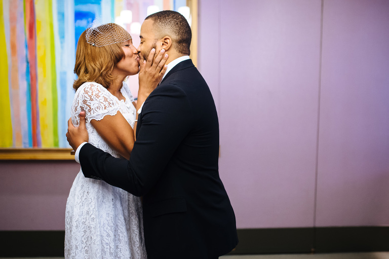 Such a sweet kiss after their City Hall wedding ceremony