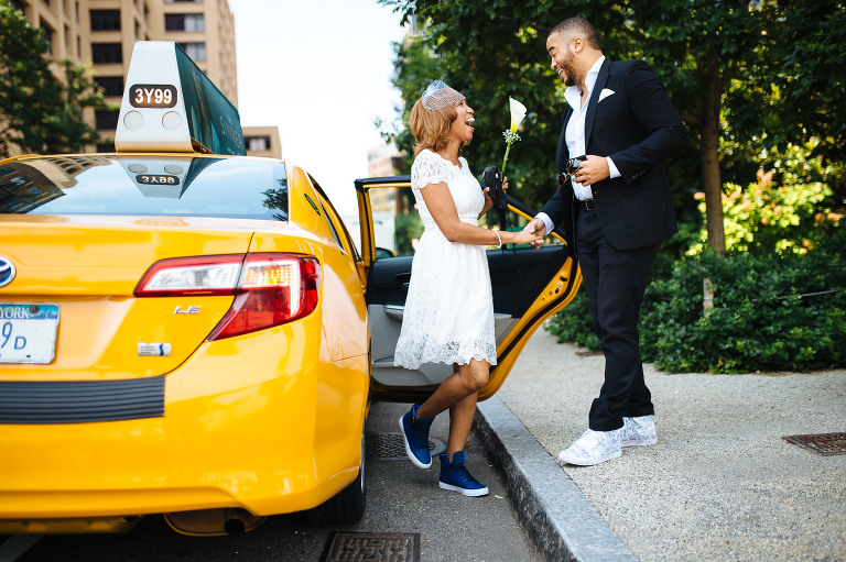 Bride getting out of the cab in Brooklyn, such great laughter