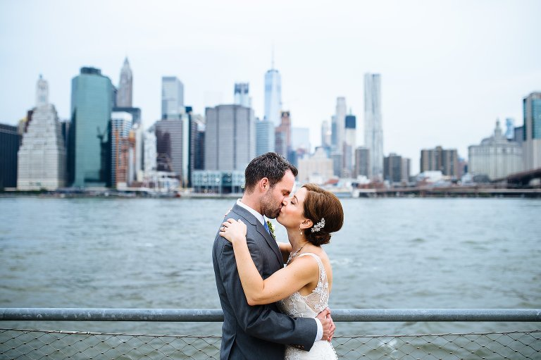 The bride and groom with the NYC skyline in the background