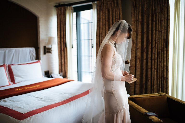 Bride writing her vows while at The Bowery Hotel, one of the best elopement hotels NYC