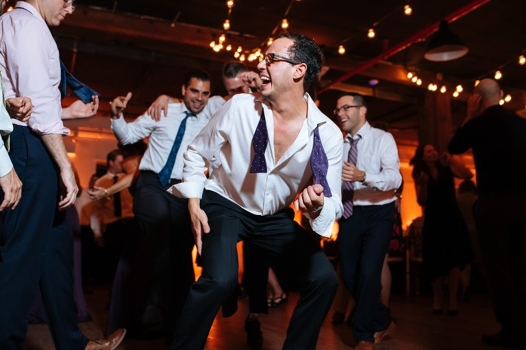 Groomsman dancing at the wedding reception in Brooklyn