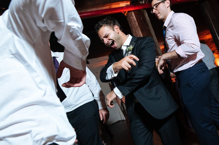 Groom dancing at his Liberty Warehouse wedding in Red Hook Brooklyn