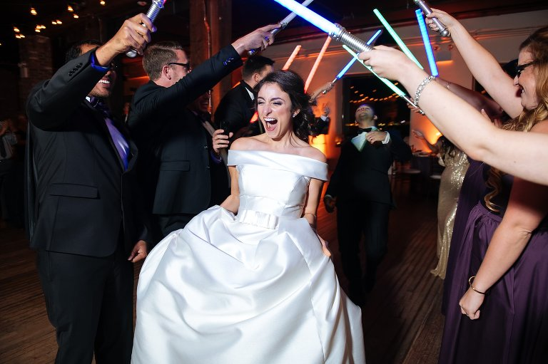 A Star Wars lightsaber wedding reception entrance for the bride and groom