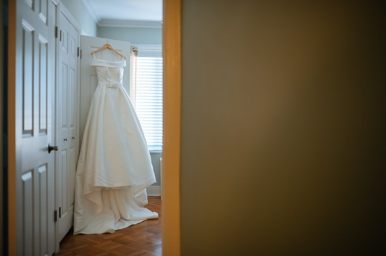 The Aire Barcelona wedding dress hanging in bride's grandmother's old bedroom
