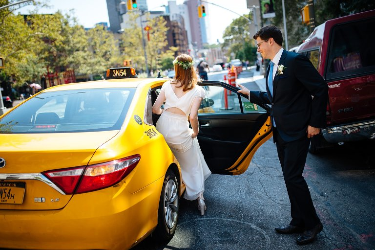 Bride and groom entering a taxi