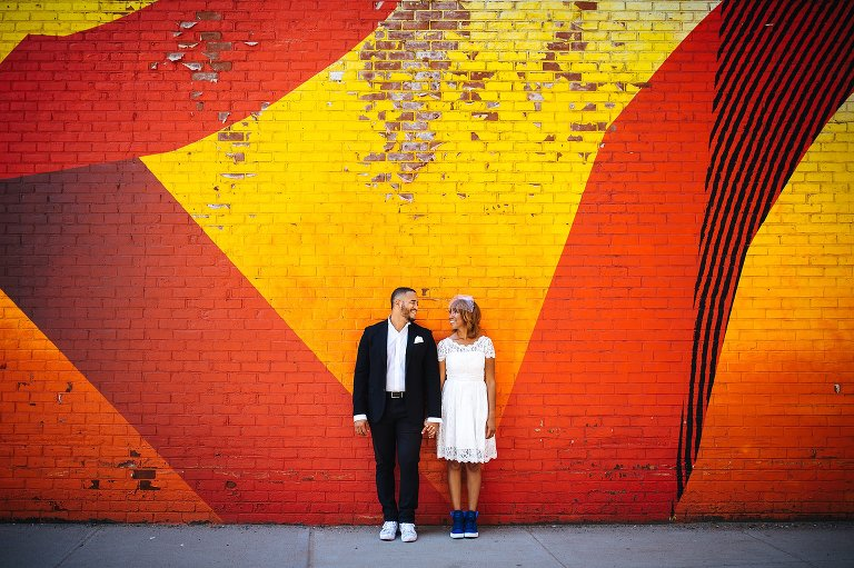 BQE wall of graffiti in DUMBO Brooklyn makes for colorful wedding photos
