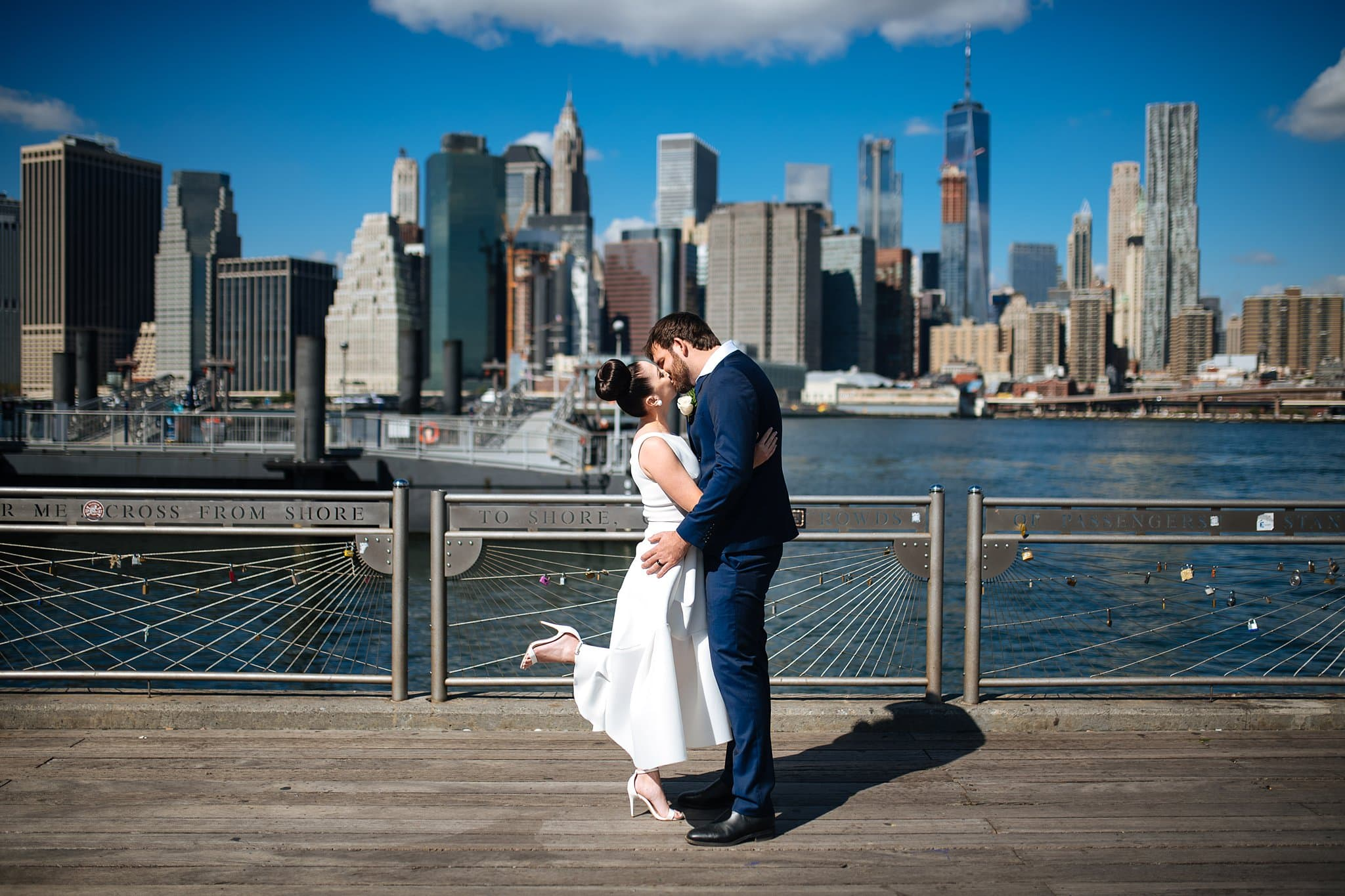 Bride and groom at Fulton Ferry Landing section of DUMBO with skyline views