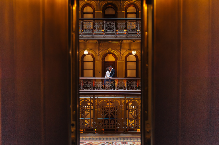 Bride and groom at The Beekman Hotel in NYC for their elopement