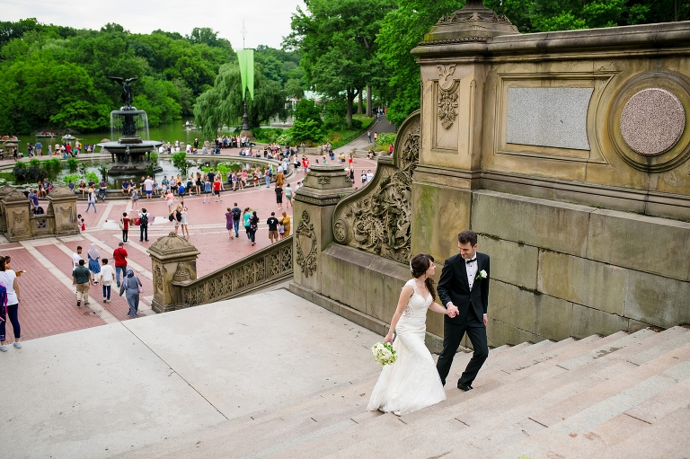 wedding couple walking Bethesda Terrace stairs