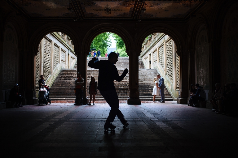 Bethesda Terrace wedding photo of bride and groom kissing