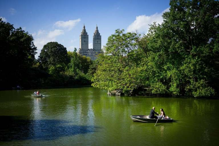 Wedding photo in Central Park with boat pond and skyline