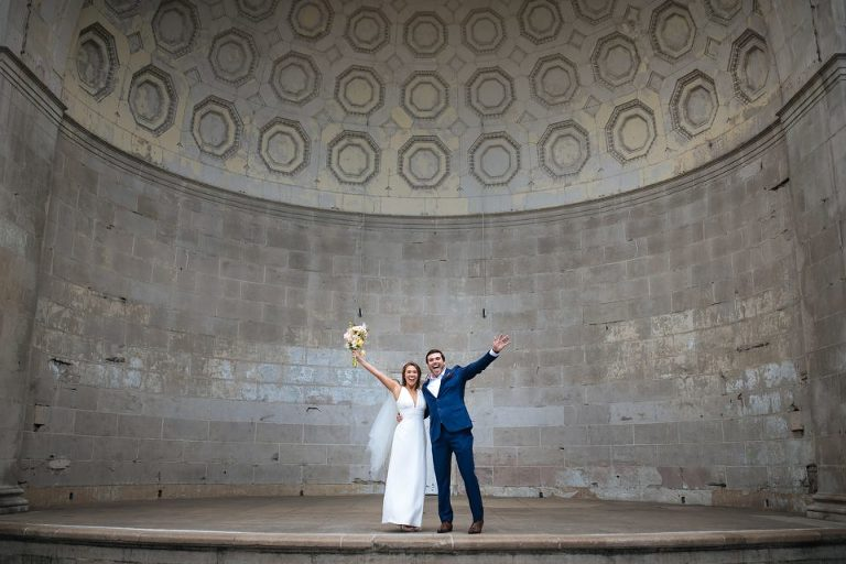 bride and groom celebrating in Naumburg Bandshell after wedding ceremony