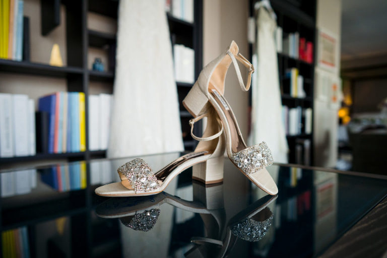 Badgley Mischka bridal shoes with Winnie Couture wedding dress in background