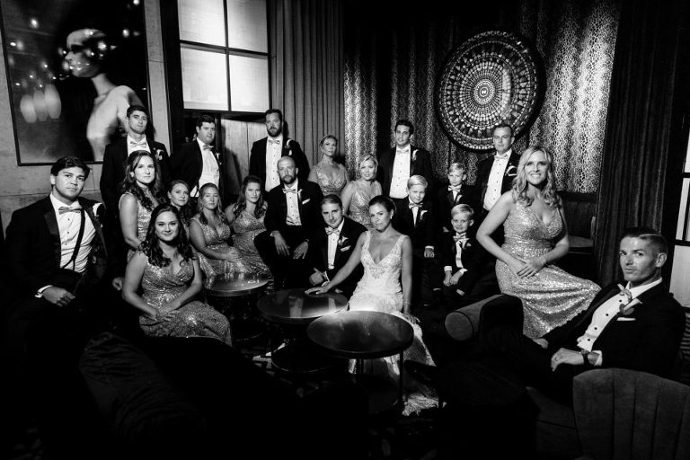 moody bridal party photo in a bar