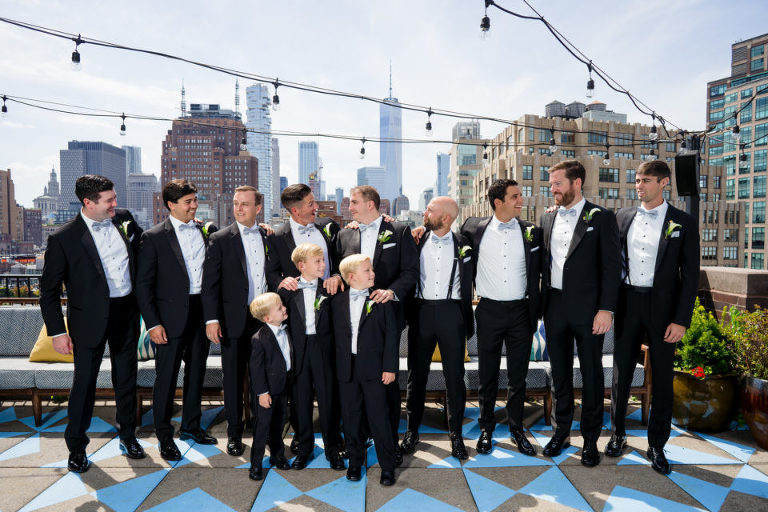 group photos of the groom and groomsmen on a NYC rooftop